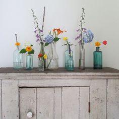 Glass bottles flower arrangement