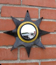 Black & yellow sunburst mirror upcycled tiller blade and blind spot adjustable convex mirror Convex Mirror, Sunburst Mirror, Car Rear View Mirror, Car Mirror, Low Growing Shrubs, Hall Mirrors, Industrial Mirrors, Garden Mirrors, Pencil Cup