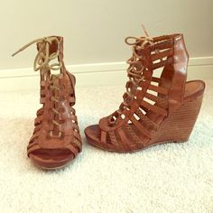 """Gladiator style lace up heels These are so cute and comfy. Boho heels that go with everything. Lightly worn. These are a 5.5 but I always wear a 6 so they run slightly big. Heel Height – 4 1/8"""". Platform – 5/8"""". Material – Faux Leather. Toe – Open. Closure – Lace-Up. Bakers Shoes"""