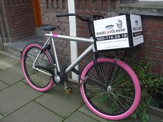 bike with purple wheels and text