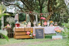 An assortment of vintage dressers and tables under a tree can serve as an enticing dessert buffet for every type of sweet tooth. Fill apothecary jars with candies, top cake stands with, well, cakes, and layer tiered trays with petit fours.
