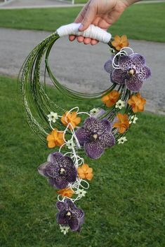 "Beautiful ""Hoop"" Wedding Bouquet Featuring: Purple Orchids, Orange Orchids, Star Of Bethlehem Blooms & Green Lily Grass/Bear Grass Creative Flower Arrangements, Floral Arrangements, Bride Bouquets, Floral Bouquets, Boquet, Ikebana, Bouquet Images, Alternative Bouquet, Hand Bouquet"