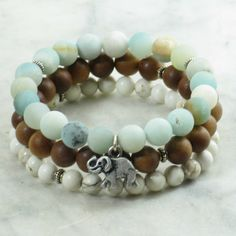 The Airavata Mala Beads Stack is made from amazonite, sandalwood, and howlite. It is completed with an antiqued elephant. Yoga bracelet for manifestation..