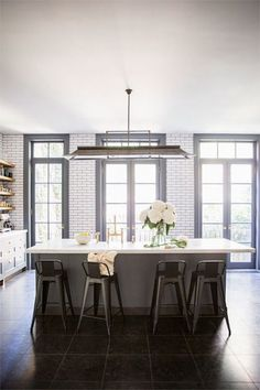 Grey kitchen, white subway tile with charcoal grout, black framed steel doors