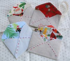 fabric envelopes. cute way to give a give card, then can double as an ornament. Might have to make a couple of these!