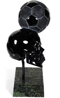 Skullis.com A Crystal Skull a Day: July 03, 2014 - Header - Black Obsidian Carved Crystal Skull with Football and Kambaba Jasper Stand Sculpture