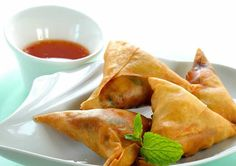 A #vegan #takeaway appetizer typical of the south #Asia, wonderful scent of oriental spices and exquisite blend of healthy vegetables. #Vegetable #samosas
