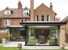 Flat roof design exterior modern with sliding glass doors glass wall brick house Extension Veranda, House Extension Plans, House Extension Design, Extension Designs, Glass Extension, Roof Extension, Extension Ideas, Extension Google, Garden Room Extensions