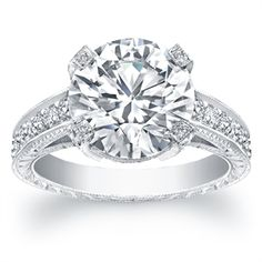 Picture of Norman Silverman - Round Brilliant Cut Diamond Set in Hand Engraved Pavé Platinum Ring