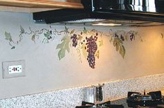 love the painted grape vine but would not trust myself to paint on the walls