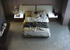 Dormitorio que combina el tapizado acolchado de la gama Sublim de Crevin con la madera de roble fumé (R30).