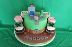 Minecraft cake with matching cupcakes.