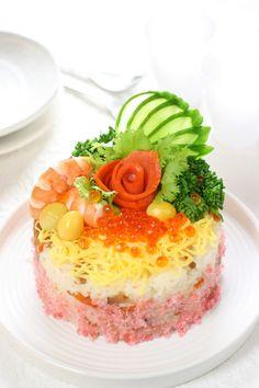 Sushi Cake (shredded omelet, shrimps, salmon roe, salmon, cucumber, broccoli rabe and ginkgo nuts on sushi rice)