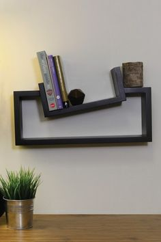 """Functional Wall Decor by Nexxt Slant Shelf - Black $28.00 This shelf would look great in office or bedroom with it's quirky slanted top shelf to display items. Wood construction in black finish. - Holds up to 5lbs. - Hanging hardware is included - Ready to hang - Color: black - Approx. 20"""" W x 11"""" L x 5"""" D - Imported"""