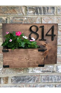 You can add a lot of curb appeal to your home with this DIY house number planter. Switching out the flowers to reflect the season will create a warm welcome for your guests. What youll need for a DIY house number planter: Arte Pallet, Diy Signs, Flower Pots, Flowers, Flower Planters, Curb Appeal, Diy Projects, Diy House Numbers, House Number Signs