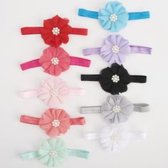 Calling all ballerinas! This soft and sweet flower headband is the perfect accessory to finish your sweet outfit. Feminine and chic you'll love this one, we promise! Pearl center finishes the bow!