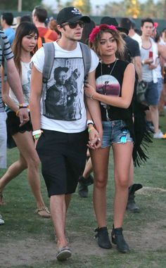 COACHELLA CUTIE Sarah Hyland rocked a rocker chic look while attending the annual AERIE +Filter Yacht Club Party, sporting a printed American Eagle tank top and cutoff denim shorts, and an aerie REAL tote bag as she made her way through the bash with boyfriend Matt Prokop.