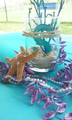 Seaside centerpieces at a mermaid birthday party! See more party planning ideas at CatchMyParty.com!