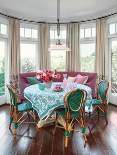 Cafe chairs and a plum bench set the tone for this breakfast area. #color #hgtvmagazine http://www.hgtv.com/design/decorating/design-101/a-grown-up-way-to-do-pastels?soc=pinterest