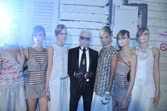 Karl Lagerfeld with models in looks from the Chanel Resort 2014 collection.