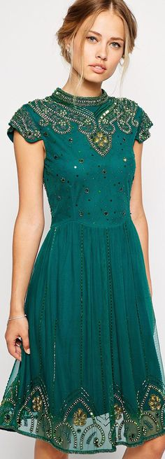 Frock and frill embellished high neck skater dress with mesh back.