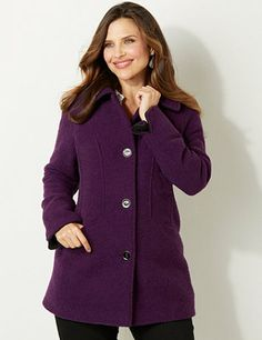 Warm up in an instant with this soft and cozy, boucled yarn coat. Fold-over collar leads to a buttonfront opening with large, enamel buttons. Back tab at the center offers an added fit at the waist. Long sleeves feature slits at the ends for optional, rolled-up wear. Complete with deep waist pockets. Catherines jackets are styled exclusively for the plus size woman. catherines.com