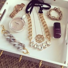 Buy gold chunky chain, tie black velvet ribbon to ends of chain, glue huge jewels to black felt & cut out
