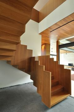 Stunning Solid Wood Stairs- so much interest in the piece.  Courtesy of a_collective