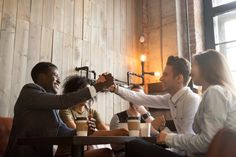 African american and caucasian men shaking hands at coffeehouse meeting with diverse friends, multiracial smiling male buddies greeting with friendship handshake sitting sharing table in cozy cafe Cozy Cafe, Coffeehouse, Best Stocks, Royalty Free Photos, Friendship, African, Hands, Stock Photos, Couple Photos
