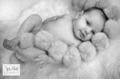 Baby photography. Black and White. Newborn. Pom Pom Blanket.