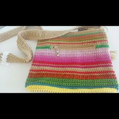 """BOGO NWT Colorful crochet the sak bag boho BUY ONE GET ONE HALF OFF.   Macy's """"the sak"""", tassel and over the shoulder fit. Received as a gift but no receipt to return!  Very very thick, not even sure if crochet is the right word for it! Zipper opening and pockets on the inside.  Firm price unless in bundle! Macy's Bags"""