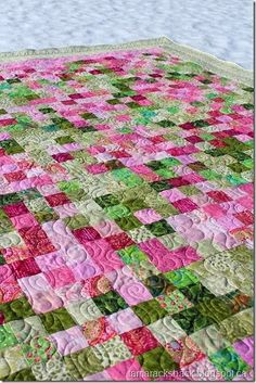 Rhubarb Pie Quilt. This lovely pieced quilt is considered a postage stamp quilt because the blocks are small, the size or a little larger than a postage stamp.