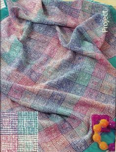 """Chenille Shadow Weave Block Baby Blanket. Think baby and think blocks! We all remember our favorite colorful wooden baby blocks!  Now you can weave these memories and images into a luscious, machine wash and dry able rayon chenille baby blanket using clever shadow weave techniques! You'll need a 36"""" wide 4-shaft loom, 12-dent reed and 2 shuttles."""