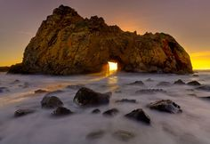 A Hole In The Wall by Kevin  McNeal    iconic location of Pfeiffer Beach.. in the months of Jan and Feb the sun lines up with the hole in the wall and really makes this an unique scene….