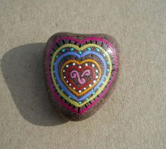 This small heart has been hand painted on exceptionally smooth water worn stone. It is a perfect companion piece to calm someone who is