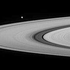 Mimas along the plane of the amazing rings of Saturn.  Cassini image.
