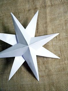 How to Make Holiday Paper Star Decorations : Page 02 : Decorating : Home & Garden Television Diy Christmas Star, Christmas Paper, Christmas Crafts, 3d Paper Star, Paper Stars, Handmade Christmas Decorations, Star Decorations, Tissue Paper Tassel, Papier Diy