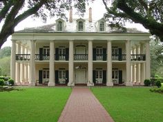 """The Bon Séjour Plantation, as Oak Alley was originally named, was established to grow sugarcane by Valcour Aime when he purchased the land, 1830. Aime, known as the """"King of Sugar,"""" was one of the wealthiest men in the South. In 1836, Valcour Aime exchanged this piece of property with his brother-in-law Jacques Télesphore Roman for a plantation owned by Roman. The following year Jacques Roman began building the present mansion under the oversight of George Swainy +entirely with enslaved…"""