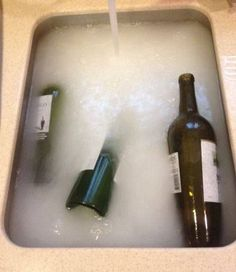This works! Soak the bottles in hot, hot, hot water. Then fill each wine bottle with hot water and drop it into the sink. Next, add this secret potion: 1/2 cup baking powder 1 Tbsp dish soap 2 cups white vinegar Once you add the vinegar to the sink, it will get all fizzy for a second AND THE LABELS COME OFF!
