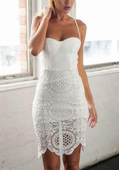 Model in white lace sweetheart sheath dress