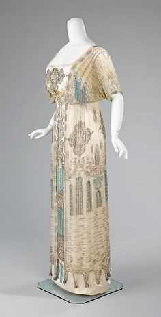 This dress is a tour de force of beadwork embroidery, indicative of French couture craftsmanship. The juxtaposition of three-dimensional and trompe l'oeil tassels is stylish and witty, and highlights the level of planning and care taken in the design of couture garments