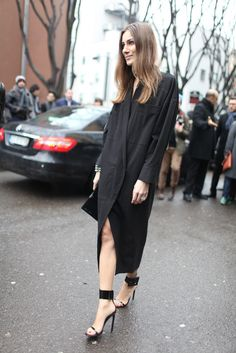 Giorgia Tordini at Milan fashion week wearing Stella McCartney dress and Gucci shoes. February 2013, Milan.