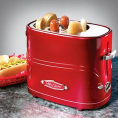 Pop-Up Hot Dog Toaster by Nostalgia Electrics ($19 USD)   Now cooking hot dogs is as simple as making toast with The Nostalgia Electrics Hot Dog Toaster.  A fast, fun and convenient way to enjoy hot dogs. Perfect for entertaining, as well as a quick meal solution.   Holds up to two regular-sized hot dogs and two hot dog buns at one time. Adjustable heat controls