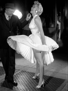 Marilyn in 1954 with director Billy Wilder during shooting of that famous scene over the NY subway vent