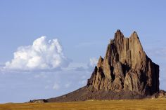 Shiprock is a rock formation rising nearly 1,800 feet (550 m) above the high-desert plain on the Navajo Nation and in San Juan County, New Mexico, about 12 miles southwest of the town of Shiprock, which is named for the peak.