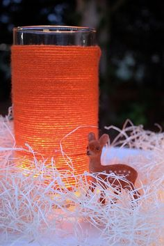 Love this. Just wind some colored yarn around glass vase leaving the top inch or 2 clear. Beautiful light from this orange color.