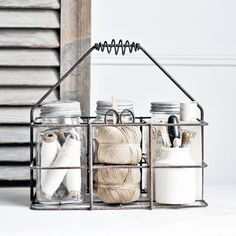 An antique French metal bottle carrier