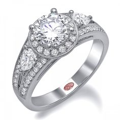 DemarcoJewelry.com  Available in White Gold 18KT and Platinum. 0.70 CTWCapture her grace and endless beauty with this confident yet elegant design. We have also incorporated a unique pink diamond with every single one of our rings, symbolizing that hidden, unspoken emotion and feeling one carries in their heart about their significant other. This is not just another ring, this is a heirloom piece of jewelry.   Demarco Bridal Engagement Ring.