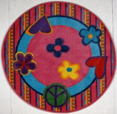"Fun Shape High Pile Peace Kids Rug Size: Round 4'3"" by Fun Rugs. $57.80. Made from 100% nylon. Round shape. Not machine washable. 51 in. Dia. (7 lbs.) Your child's room is a natural extension of them. Add these innovative designs from LA Rug to spruce up any child's decor.. Spot clean using mild soap and cold water. FTS-180 51RD Size: Round 4'3"" Features: -Machine made with 100pct nylon.-Kids rug with non-skid backing for extra safety.-Image of peace signs with ..."