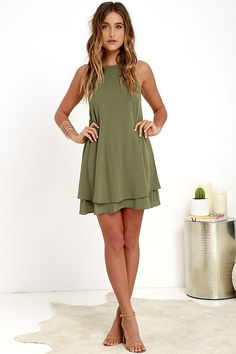 As you travel city streets, the Sights and Sounds Olive Green Swing Dress is sure to entice all that pass by! Gauzy woven rayon creates a breezy swing silhouette from an apron neckline, down to a tiered hem. V-back offers a sultry peek of skin. Adjustable spaghetti straps.